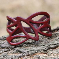 Red leather cuff bracelet with cut out detailing