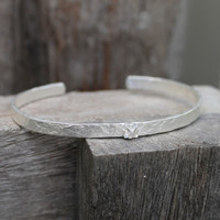 textured silver adjustable cuff with white stone