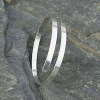 Polished silver wrap bangle without wording