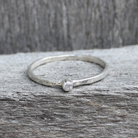 Sterling silver ring with solitaire white stone