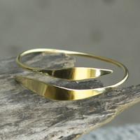 Adjustable, feminine brass bracelet