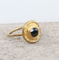 14 carat gold plated sterling silver ring with black stone detailing