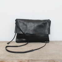 black genuine leather fold over crossbody bag with minimalist adjustable strap
