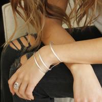 minimalist asymmetrical adjustable statement cuff in silver plated brass