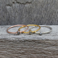 Gold, rose gold & sterling silver ring with raw diamond center stone