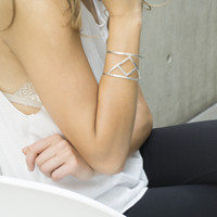 silver statement cuff featuring Transition glyph symbol