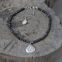 silver 'transition' glyph bracelet with genuine hematite stones