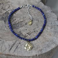 brass 'protect' glyph bracelet with genuine lapis lazuli stones