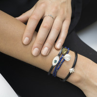silver and brass 'protect' glyph bracelets with genuine lapis lazuli stones