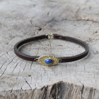chocolate leather bracelet with brass and lapis lazuli detailing
