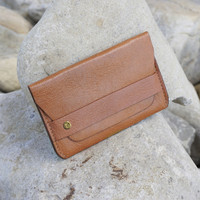 caramel leather card case with 'take more detours' brass plate