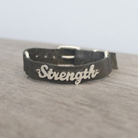 Grey leather bracelet with silver STRENGTH detail