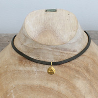 """grey leather necklace with brass """"explore"""" pendant"""