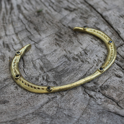 adjustable brass bracelet with black stone detail