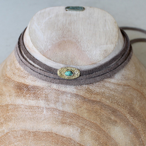 grey leather wrap necklace with brass and turquoise detail