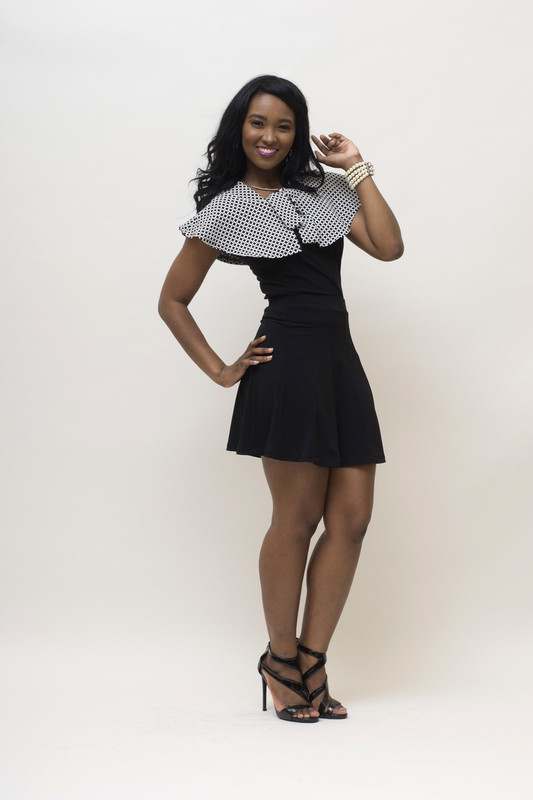 Shown here with the black BePear sleeveless blouse and jacquard peplum/shall.