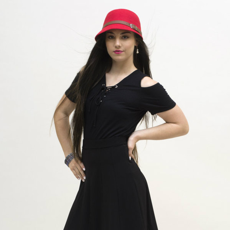 Here's our lace-up cold shoulder top matched with our black panel skirt.  For reference, model is a SMALL size.