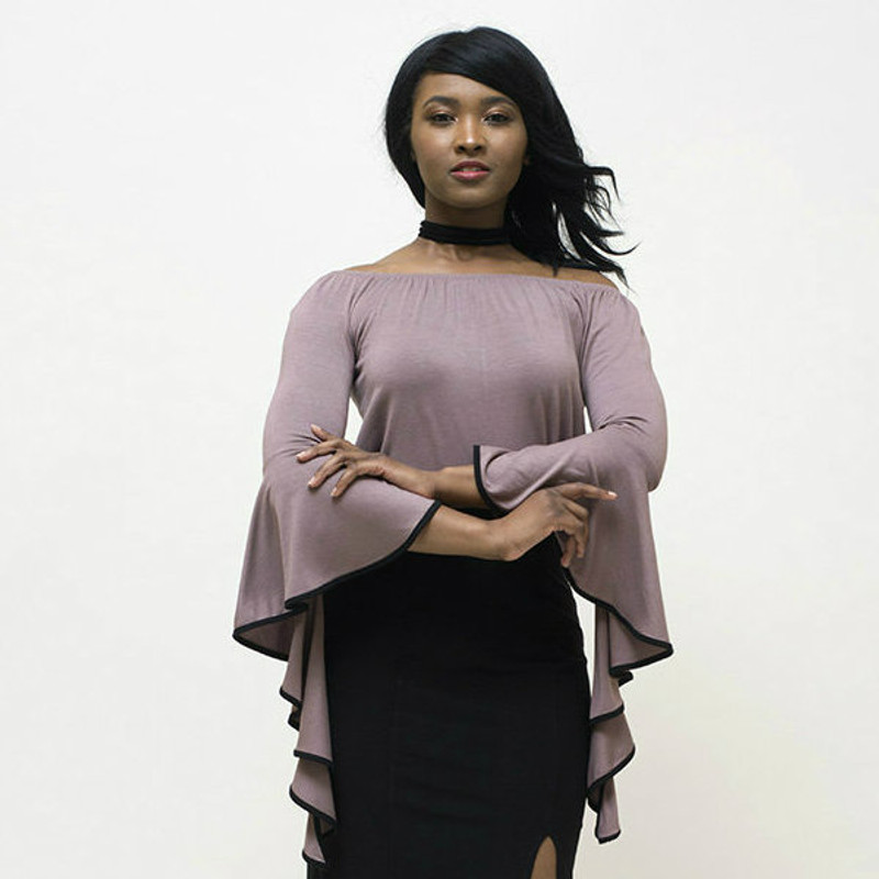 Goes amazingly well with our long black pencil skirt.  For reference, model is a SMALL size.