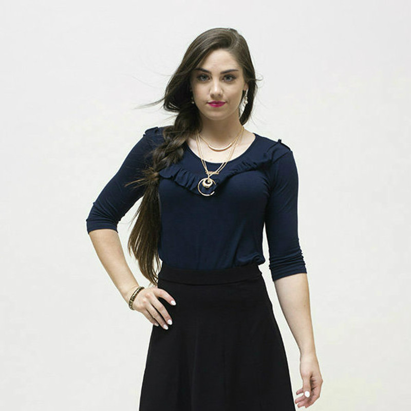 Here, the top is matched with our long panel skirt and sandals for a casual look.