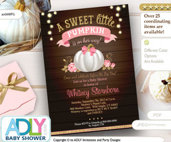 White Gold Pumpkin with Pink Bow and Brown wooden, rustic background