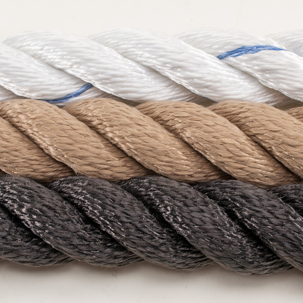 Tug of war rope in black, tan, and white with blue tracer.