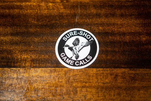 From the inventors of the Double Reed Duck Call, Triple Reed Duck Call, and the YENTZEN Classic..... Our logo styled in a durable and waterproof outdoor sticker. Weather and Waterproof UV Coated for durability Black and White colors Represent the Sure-Shot brand