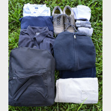 Hospitality Beyond Borders Backpack with clothes