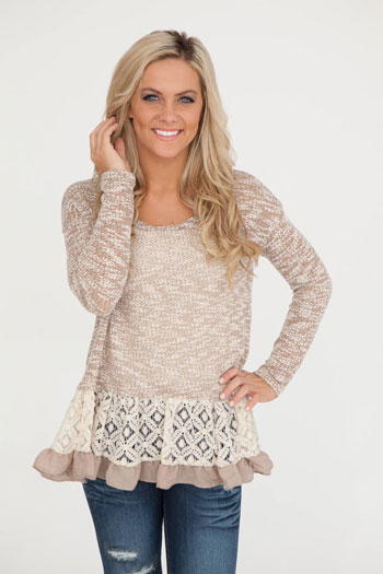 smiling girl in tan sweater