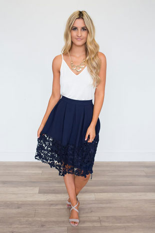 girl in navy skirt and white top