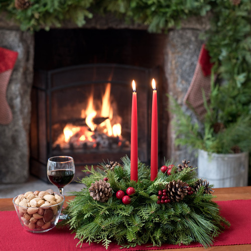 New England Maine Christmas centerpiece with pine cones, faux berries and cherries, and holly red candles