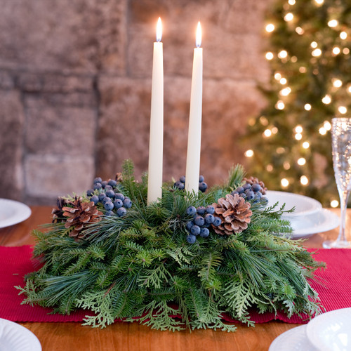 Blueberry Christmas table centerpieces with pine cones, faux blueberries, and ivory candles