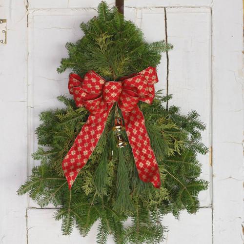 fresh holiday door swag of balsam fir pine and cedar brass bells and