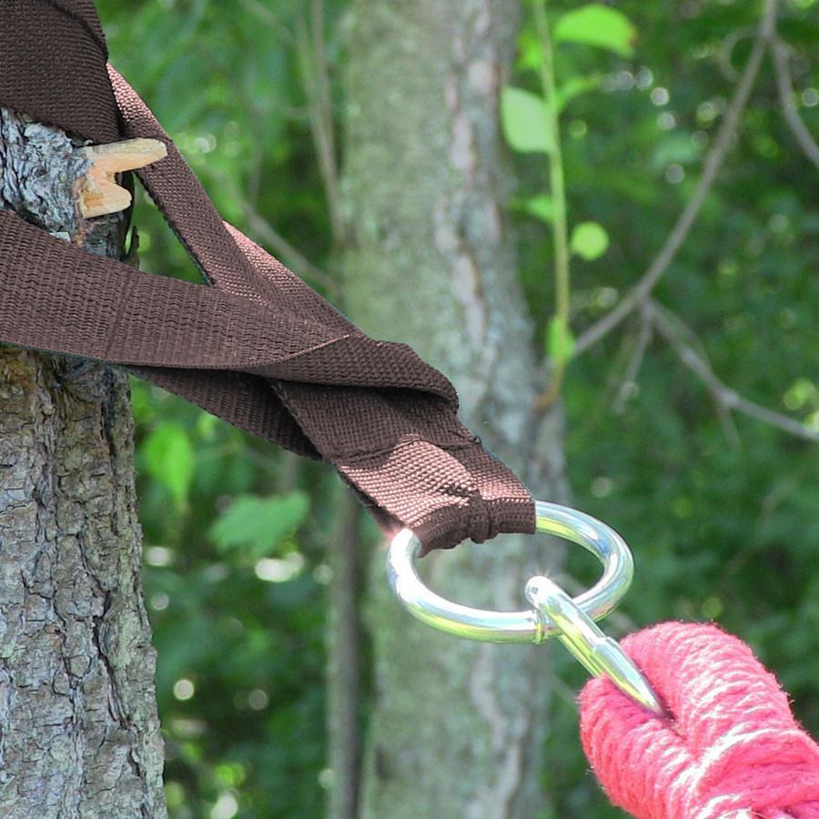 Brown hammock tree strap in use