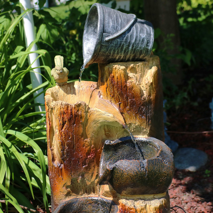 Top of Cascading Log and Buckets Water Fountain