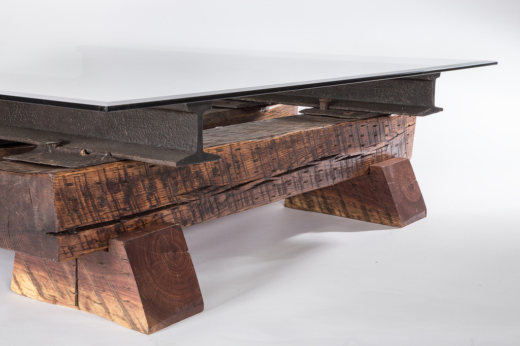 i-beam construction coffee table with wood beam timbers and glass top