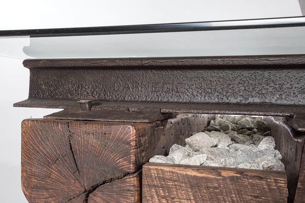 historic reclaimed iron artifacts from industrial age tycoons remade into tables and furniture
