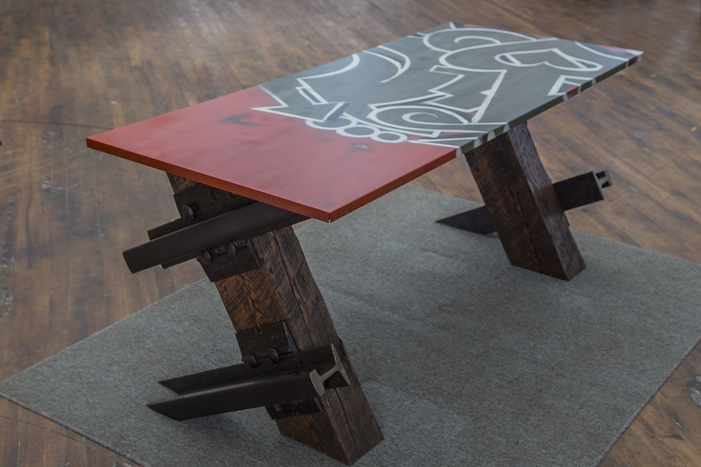 red white and black graffiti style table with cantilevered legs