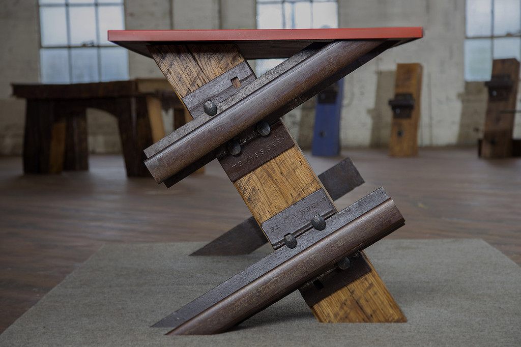 cantilevered steel and wood table desk with red desktop