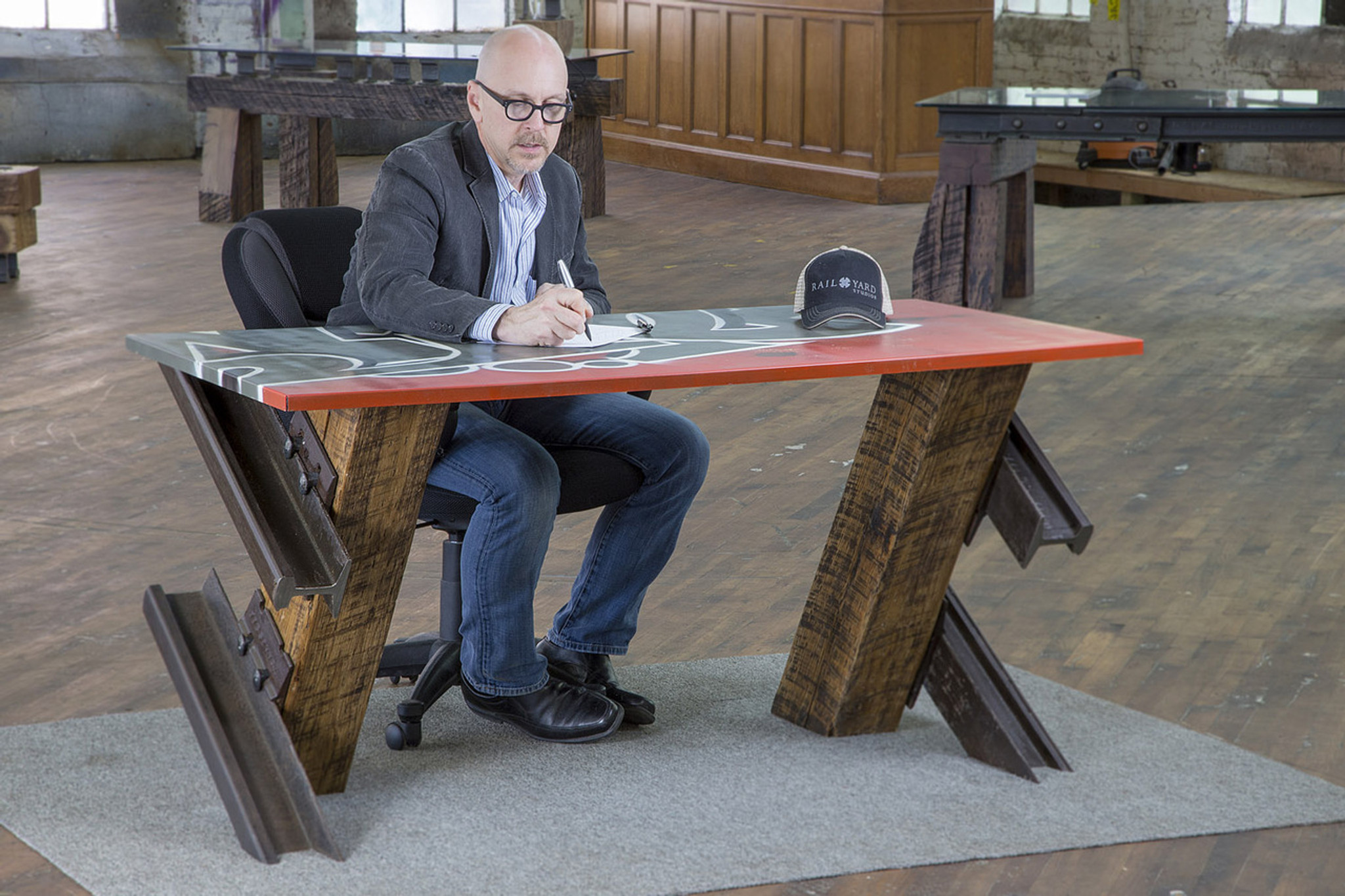 urban loft graffiti art style desk with reclaimed wood and steel legs in renovated warehouse