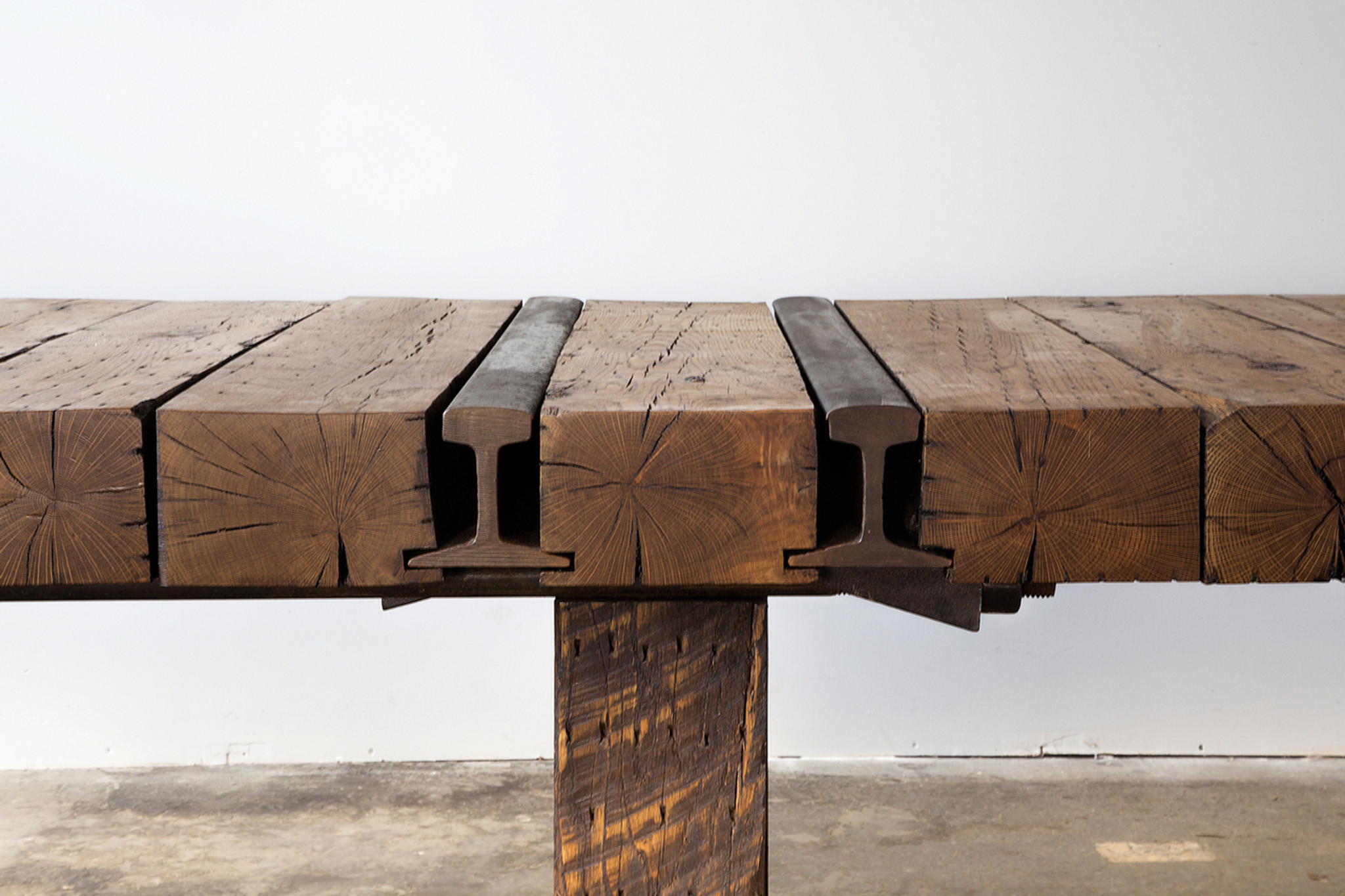 artisan detailed conference room table from reclaimed timber beams and industrial steel i-beams