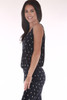 side shows navy and white polka dot print all over with spaghetti straps and waistband.