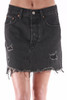 front shows deconstructed black denim skirt features a button fly front with classic 5-pocket fit, distressing at front and back and unfinished hemline for an awesome vintage look.