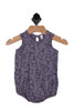 Front shows purple bubble onesie with ice cream cone pattern all over.