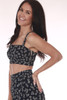 side shows very cropped hemline black top with small white flower pattern, adjustable thick spaghetti  straps and thicker silver zipper on left side. Shown paired with the matching floral maxi skirt.