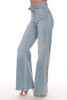 side shows belted top with no front pockets and super wide flare bottoms in a light blue denim color