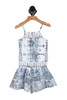 Front shows One piece skirt romper  with multi blue and crochet patterns. Buttons at the top.