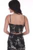 Back shows black jumper suit with white floral print pattern, adjustable spaghetti straps, black slit, and corset hooks.