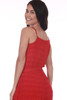Back shows red cropped jumpsuit with spaghetti straps and waste tie.