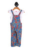 Front shows adorable over-all jumpsuit set with red and blue Hawaiian style palm trees and grey background. Comes with attached white tee shirt.