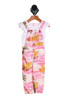 Front shows adorable over-all jumpsuit set with yellow Hawaiian style palm trees with pink and white background. Comes with attached white tee shirt.